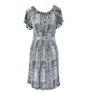 7c582d41f79 BCBGMaxAzria Dresses - BCBGMazAzria Stretchy Python Print Dress